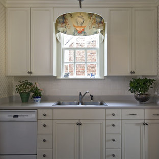 Photo of a traditional kitchen in Richmond with white appliances.
