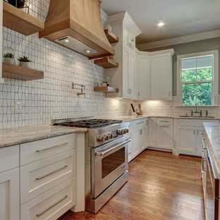 Photo of a large traditional eat-in kitchen in Other with an undermount sink, recessed-panel cabinets, white cabinets, marble benchtops, white splashback, mosaic tile splashback, stainless steel appliances, medium hardwood floors, with island and green benchtop.