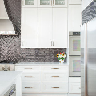 Inspiration for a large classic l-shaped kitchen/diner in Dallas with a double-bowl sink, recessed-panel cabinets, white cabinets, engineered stone countertops, brown splashback, ceramic splashback, stainless steel appliances, medium hardwood flooring, an island, brown floors and yellow worktops.