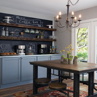 Inspiration for a medium sized country kitchen/diner in New York with shaker cabinets, blue cabinets, black splashback and medium hardwood flooring.