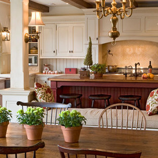 Eat-in kitchen - country eat-in kitchen idea in Philadelphia with raised-panel cabinets and white cabinets