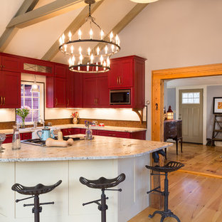 Inspiration for a cottage eat-in kitchen remodel in Boston with a farmhouse sink, recessed-panel cabinets and red cabinets