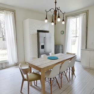Mid-sized scandinavian eat-in kitchen ideas - Inspiration for a mid-sized scandinavian u-shaped painted wood floor eat-in kitchen remodel in New York with an undermount sink, flat-panel cabinets, white cabinets, quartz countertops, white backsplash, stainless steel appliances and no island