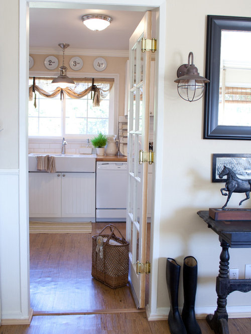 Example Of A Country Kitchen Design In Los Angeles With A Farmhouse Sink  And White Appliances