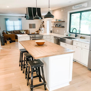 Farmhouse Kitchen remodel, white cabinets, butcher block island, glass tile back