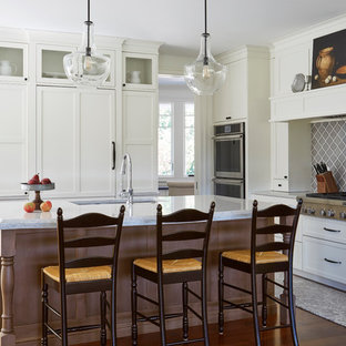 Farmhouse Kitchen with Brown Island and White Perimeter Cabinets