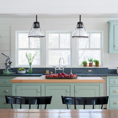 Example of a mid-sized cottage galley eat-in kitchen design in New York with beaded inset cabinets, soapstone countertops, stainless steel appliances, an island and green cabinets