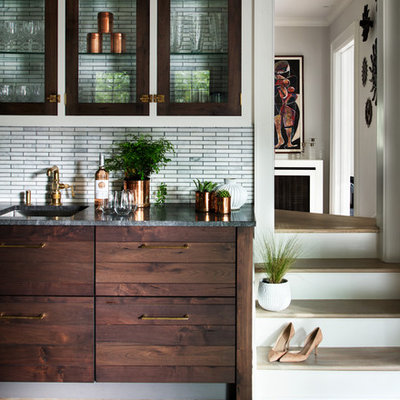Example of a mid-sized country u-shaped light wood floor and brown floor open concept kitchen design in New York with an undermount sink, shaker cabinets, gray cabinets, granite countertops, gray backsplash, mosaic tile backsplash, colored appliances and an island