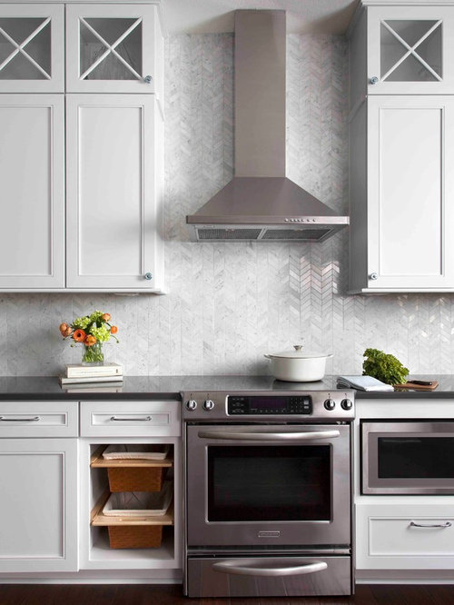 Inspiration For A Large Transitional Kitchen Remodel In Austin With White  Cabinets, Stone Tile Backsplash