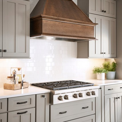 Example of a large farmhouse l-shaped eat-in kitchen design in Other with shaker cabinets, gray cabinets and an island