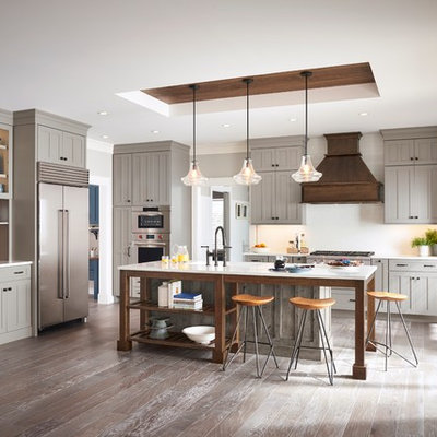 Inspiration for a large farmhouse l-shaped eat-in kitchen remodel in Other with shaker cabinets, gray cabinets and an island