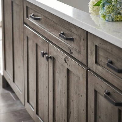 Inspiration for a large cottage l-shaped eat-in kitchen remodel in Other with shaker cabinets, gray cabinets and an island