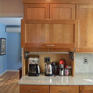 Traditional eat-in kitchen pictures - Elegant u-shaped eat-in kitchen photo in Boston with an undermount sink, recessed-panel cabinets, light wood cabinets, granite countertops and stainless steel appliances