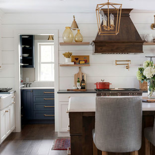 Large farmhouse eat-in kitchen remodeling - Inspiration for a large farmhouse eat-in kitchen remodel in Minneapolis with a farmhouse sink, stainless steel appliances, an island and shiplap backsplash