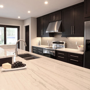 Example of a trendy galley eat-in kitchen design in Cincinnati with an undermount sink, shaker cabinets, dark wood cabinets, quartzite countertops, glass tile backsplash and stainless steel appliances