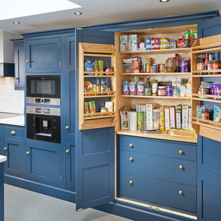 Feature larder unit in luxurious blue kitchen in Rothley, Leicestershire
