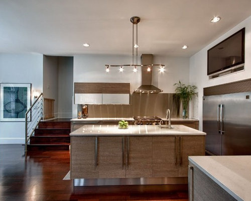 Example Of A Minimalist Open Concept Kitchen Design In Atlanta With  Stainless Steel Appliances
