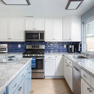 Design ideas for a mid-sized transitional galley separate kitchen in Los Angeles with a single-bowl sink, beaded inset cabinets, white cabinets, granite benchtops, blue splashback, ceramic splashback, stainless steel appliances, ceramic floors, with island, beige floor and blue benchtop.