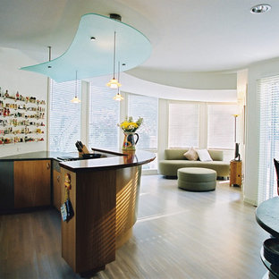Inspiration for a contemporary open concept kitchen remodel in Kansas City with flat-panel cabinets and medium tone wood cabinets