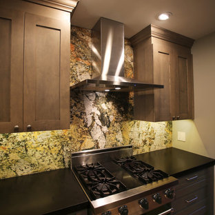 Small traditional galley enclosed kitchen in Detroit with an integrated sink, shaker cabinets, grey cabinets, granite worktops, green splashback, stone slab splashback, black appliances, medium hardwood flooring, no island and brown floors.