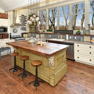 Rustic kitchen appliance - Mountain style u-shaped dark wood floor kitchen photo in Minneapolis with a drop-in sink, recessed-panel cabinets, white cabinets and an island