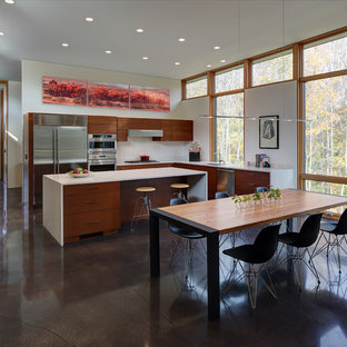 Open concept kitchen - mid-sized contemporary l-shaped concrete floor and brown floor open concept kitchen idea in Milwaukee with flat-panel cabinets, medium tone wood cabinets, stainless steel appliances, an undermount sink and an island