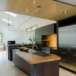 Example of a trendy galley open concept kitchen design in DC Metro with stainless steel appliances and a single-bowl sink