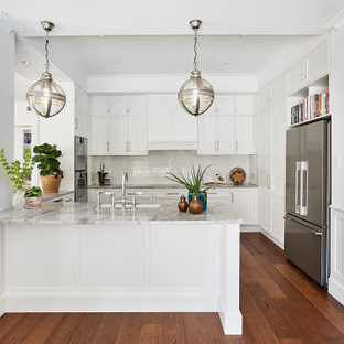 Design ideas for a traditional kitchen in Brisbane with marble benchtops, an integrated sink, shaker cabinets, white cabinets, white splashback, subway tile splashback, medium hardwood floors, with island and multi-coloured benchtop.