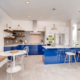 Contemporary open concept kitchen ideas - Open concept kitchen - contemporary single-wall open concept kitchen idea in Denver with an undermount sink, flat-panel cabinets, blue cabinets, gray backsplash, an island and white countertops