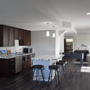 This is an example of a large transitional single-wall open plan kitchen in Other with vinyl floors, an undermount sink, shaker cabinets, dark wood cabinets, quartzite benchtops and with island.