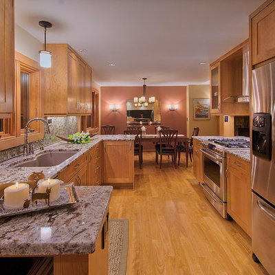 Example of a mid-sized classic galley eat-in kitchen design in Denver with an undermount sink, shaker cabinets, medium tone wood cabinets, mosaic tile backsplash and stainless steel appliances