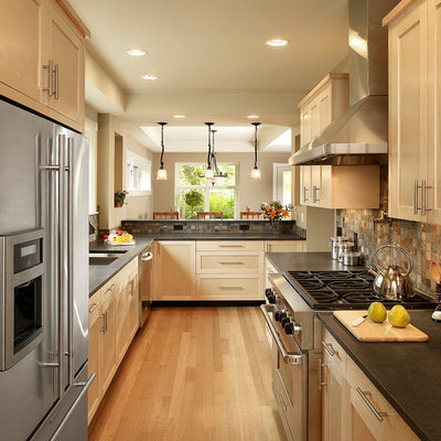 Inspiration for a mid-sized craftsman galley light wood floor and beige floor eat-in kitchen remodel in Detroit with an undermount sink, shaker cabinets, light wood cabinets, multicolored backsplash, stone tile backsplash, stainless steel appliances, a peninsula, soapstone countertops and black countertops