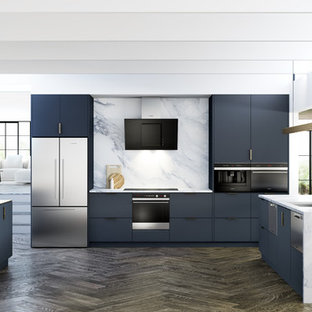 Large contemporary u-shaped open plan kitchen in Buckinghamshire with a built-in sink, flat-panel cabinets, blue cabinets, marble worktops, white splashback, marble splashback, stainless steel appliances, dark hardwood flooring and an island.
