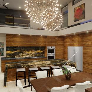 フェニックスのモダンスタイルのおしゃれなキッチン (フラットパネル扉のキャビネット、中間色木目調キャビネット、御影石カウンター、シルバーの調理設備、磁器タイルの床、白い床、黒いキッチンカウンター) の写真