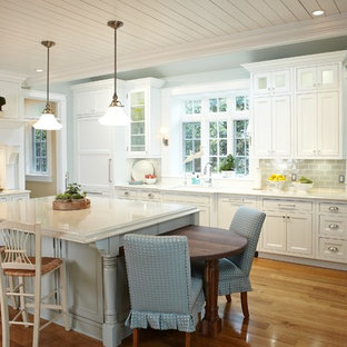 Traditional kitchen ideas - Kitchen - traditional kitchen idea in Grand Rapids with recessed-panel cabinets, white cabinets, gray backsplash and subway tile backsplash