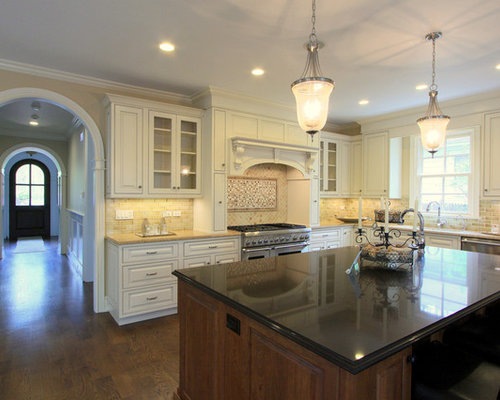 Cocolate truffle caesarstone houzz for Chocolate kitchen cabinets with stainless steel appliances