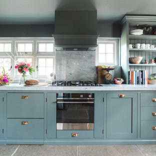 Design ideas for a small traditional kitchen in Sussex.