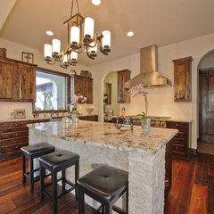 mediterranean kitchen by Robert Stephen Homes, Ltd.
