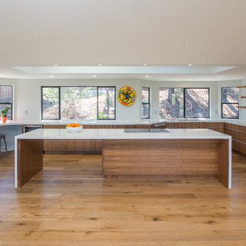 Floating double sided island rift cut walnut Kitchen cabinets