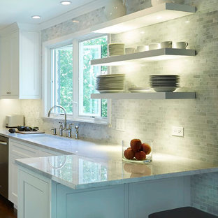 Inspiration for a mid-sized modern galley dark wood floor eat-in kitchen remodel in Chicago with an undermount sink, recessed-panel cabinets, white cabinets, quartzite countertops, multicolored backsplash, stone tile backsplash, stainless steel appliances and a peninsula