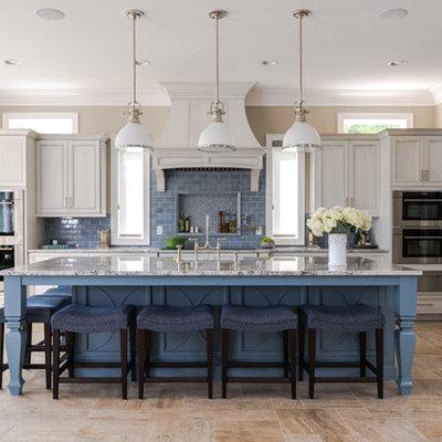 Inspiration for a coastal l-shaped beige floor kitchen remodel in Other with blue cabinets, blue backsplash, subway tile backsplash, an island and recessed-panel cabinets