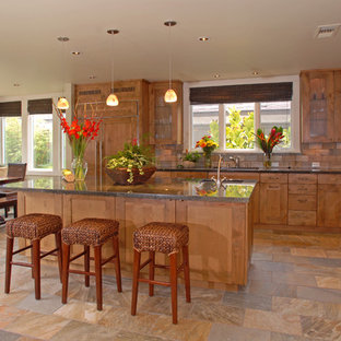 Inspiration for a mid-sized transitional l-shaped open plan kitchen in San Diego with an undermount sink, shaker cabinets, medium wood cabinets, granite benchtops, beige splashback, panelled appliances, with island, slate splashback, slate floors and beige floor.