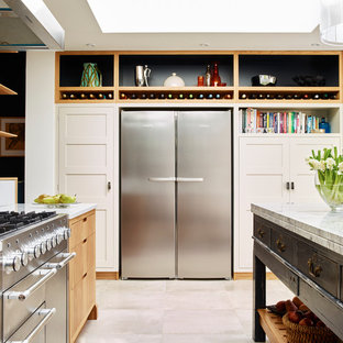 Large contemporary open concept kitchen inspiration - Large trendy porcelain floor open concept kitchen photo in London with solid surface countertops, glass sheet backsplash, stainless steel appliances and an island