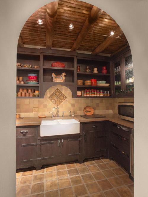 Southwestern Kitchen with Dark Wood Cabinets Design Ideas & Remodel Pictures | Houzz