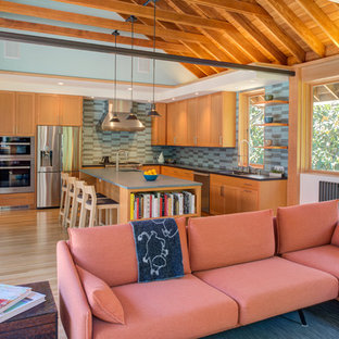 Craftsman kitchen pictures - Kitchen - craftsman l-shaped light wood floor and beige floor kitchen idea in San Francisco with an undermount sink, shaker cabinets, medium tone wood cabinets, green backsplash, stainless steel appliances, an island and gray countertops