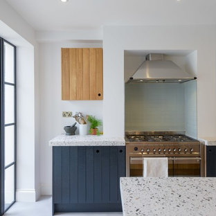Design ideas for an industrial kitchen in London with terrazzo benchtops.