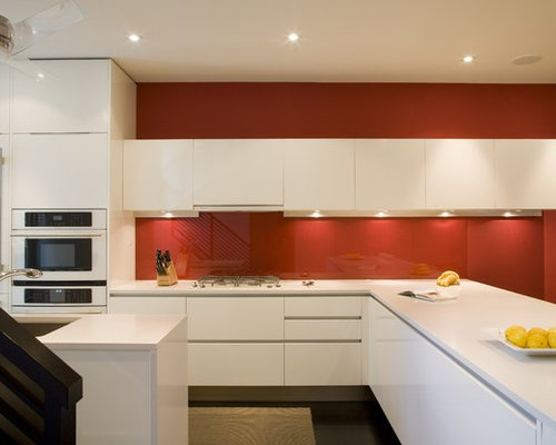 Example of a minimalist kitchen design in DC Metro with white appliances,  an undermount sink