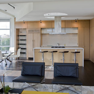 Inspiration for a contemporary open concept kitchen remodel in DC Metro with flat-panel cabinets, light wood cabinets, quartz countertops, paneled appliances, beige backsplash and stone slab backsplash