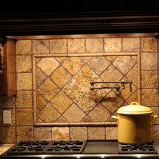 Mediterranean Kitchen by Atkinson Construction and Development, Inc.