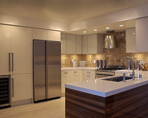 Beautiful White Kitchen Sub Zero With Blue Backsplash